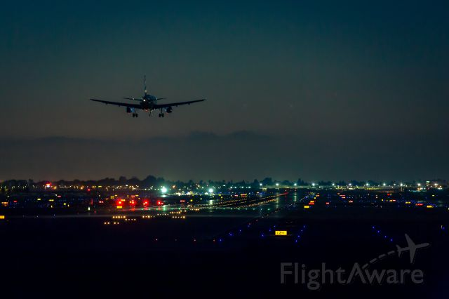 Airbus A320 — - About to touch down at KLGB