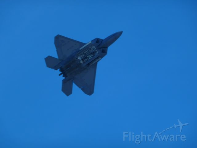 — — - F-22 showing off its payload