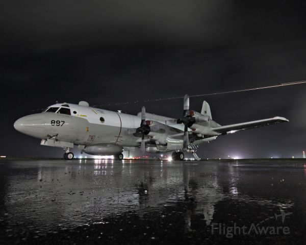 Lockheed P-3 Orion (15-9887) - EP-3E from VQ-1 World Watchers.  A C-130 is departing in the background.  Night shot was at a base in the Pacific.  This photo is a lot sharper on Flickr, however, I