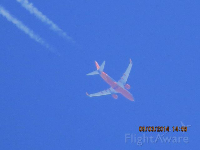 Boeing 737-700 (N7745A) - Southwest Airlines flight 4120 from PHX to SDF over Baxter Springs KS (78KS) at 39k feet.