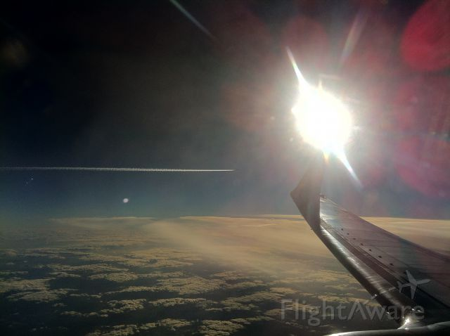 Boeing 737-700 — - From AMS to BUD. Sun, traffic on the left over Clouds