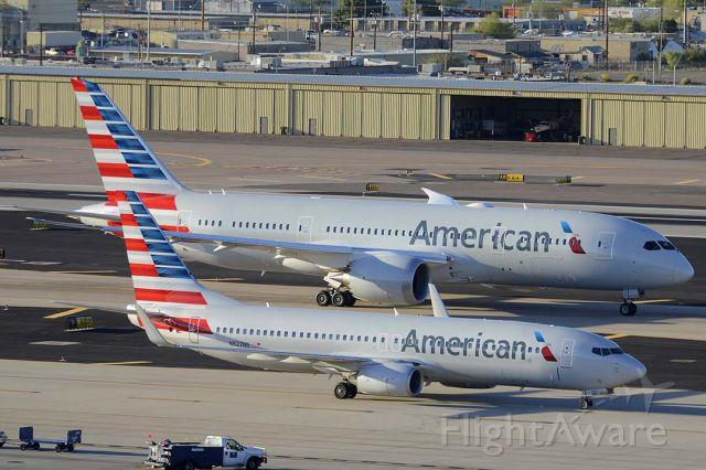 Boeing 737-800 (N827NN) - American Boeing 737-823 N827NN taxis past American Boeing 787-823 N801AC at Phoenix Sky Harbor on March 10, 2015.