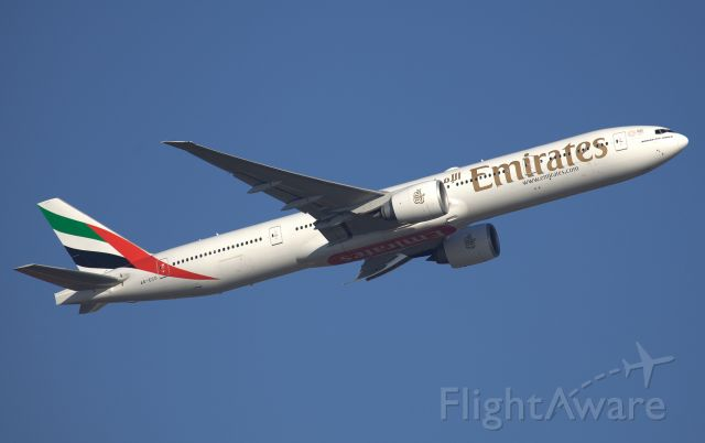 BOEING 777-300ER (A6-ECO) - Climbing from Rwy 34L