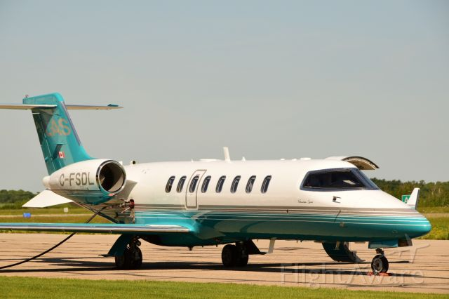 Bombardier Learjet 75 (C-FSDL) - Quick re-fuel at CYQV.