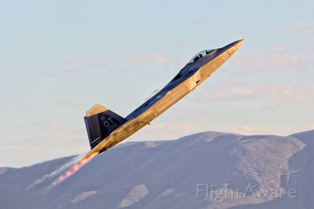 "Lockheed F-22 Raptor — - Taking off at the first ever Planes of Fame Twilight Airshow. <br /><br /><a rel=""nofollow"" href=""http://www.adler-photo.com"">www.adler-photo.com</a>"