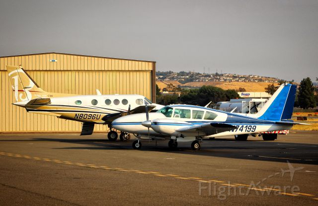 Piper Apache (N74199) - Two twins sitting on the ramp as the sun sets over Reid Hillview.