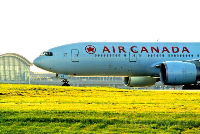 BOEING 777-200LR (C-FNND) - Air Canada 777-200LR beginning roll off of 24R at Pearson