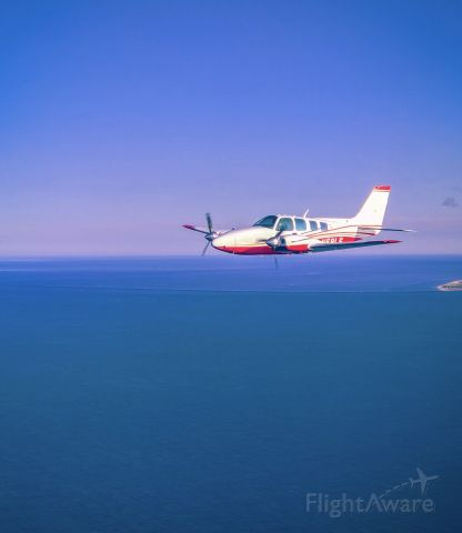 Beechcraft Baron (58) (N58LS) - formation flying over Cape Cod
