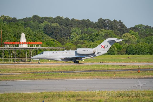 Cessna Citation X (N765XJ) - Landing at PDK airport on a slightly grey day.