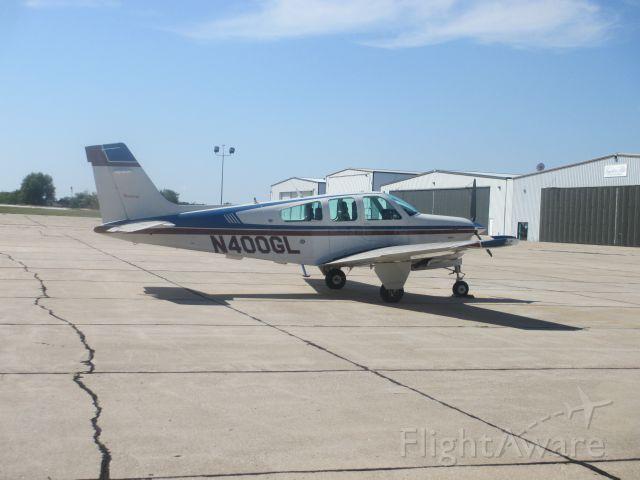 Beechcraft Bonanza (33) (N400GL) - Beechcraft 35 Bonanza Parked at Joplin on 31 AUG 2014