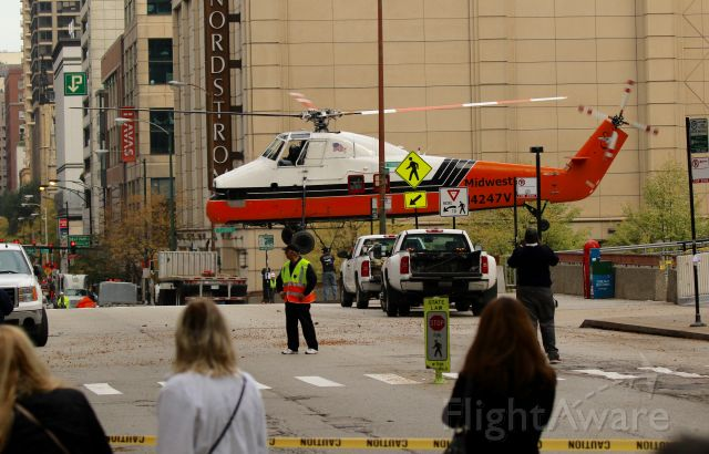 Aerospatiale Dauphin 2 (SA-365C) (N4247V) - Ground crew removing the lifting strap, after rooftop delivery. Downtown Chicago.