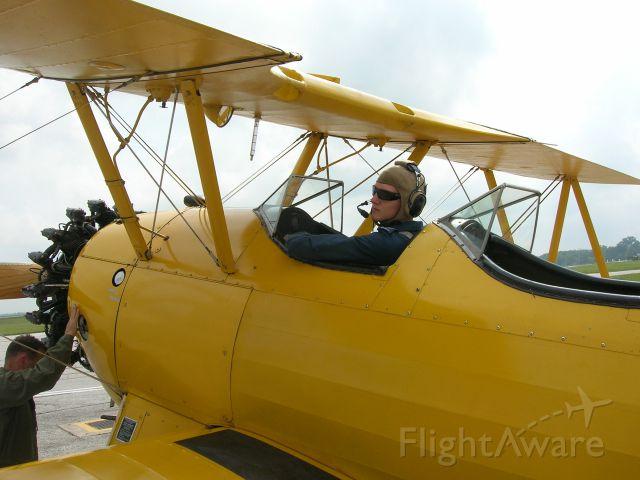 C-FAPG — - My son prepares for a flight in a 1941 Boeing Stearman.
