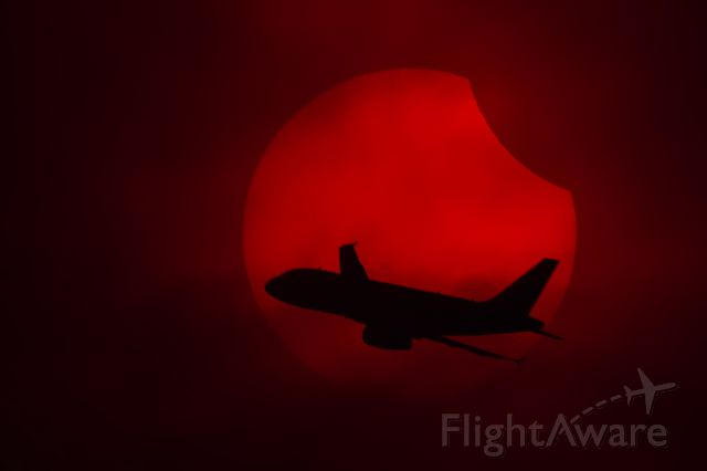 Airbus A319 (N504VL) - I was taking photos of last year partial solar eclipse (oct 23). From my vantage position, the sun was in a trajectory that would intercept the final turn to MEX final approach to 05 rwy.  Luck and opportunity coincided that day.