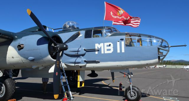 """N5865V — - As I promised when I posted the first photo of the CAF So. California Wings newest warbird to take to the skies again, here is a second snap of """"Semper Fi,"""" a North American B-25J Mitchell bomber (formerly 44-30988, now N5865V), captured here while on static display at the annual Truckee Airport Family Air Fest event.  This second picture, clicked from the sunlit side of the Camarillo, CA., based """"Semper Fi,"""" brightly highlights the tri-color camo paint scheme and, flying openly and freely in the strong wind, the flags of the United States and of the US Marine Corps.  The """"MB-11"""" lettering honors Marine Bombing Squadron 611.  To the best of anyones knowledge, """"Semper Fi"""" is the only PBJ-1J model to be flying today.  The restoration project took over two decades to complete, and it was just two months ago, in May (2016), that this superb Mitchell bomber made its first flight after being restored."""