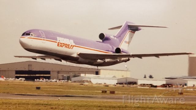 N243FE — - Flyby after conversion from Ansett Airlines tail number VH-RML serial number 21480 into freighter on delivery day Jan. 10, 1990. Work performed at the hangar in background is Tramco / BF Goodrich Aerospace, Paine Field, Everett, Washington. South end of field.