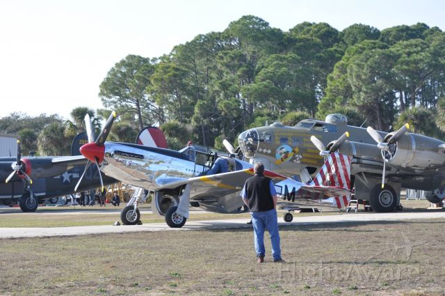 — — - P-51 preparing for flight.  B-17 after flight.  B-24 just before flight...in background.