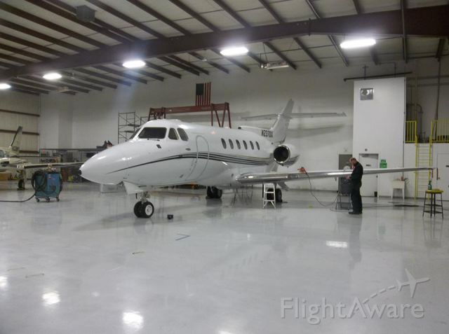 Raytheon Hawker 800 (N237DX) - Premier Flight hangar.