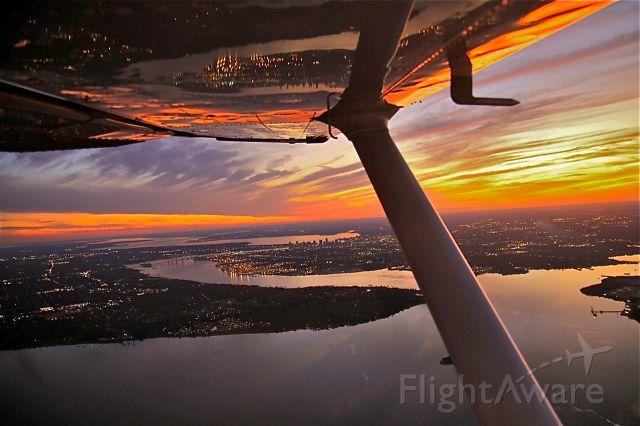 Cessna 206 Stationair (N450TP) - The sun and the bird on final approach over Jacksonville, FL.