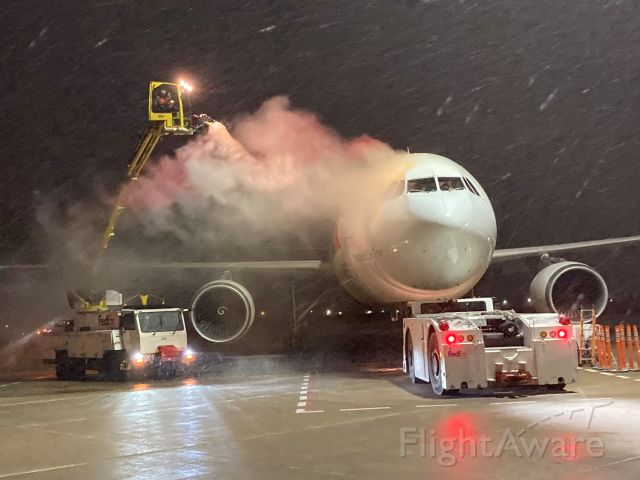 """Airbus A300F4-600 (N674FE) - """"Mark"""" is getting a quick shot of Type 1 Deicing Fluid during a heavy wet snowfall on Monday night March 15 '21.  Flight 325 is a few minutes away from a speedy departure to Madison, WI followed by Memphis."""