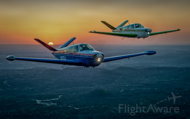 Beechcraft 35 Bonanza (N113TW) - N113TW and N61JL Cruising the Texas Hill Country at Dusk..Photography by Glenn Watson of Mach Point One Aviation.