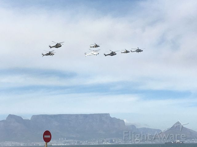 — — - Made in South Africa: 3 Atlas Oryx and 4 Denel Rooivalk. The white Rooivalk is in UN livery for service with UN peacekeeping forces in DRC.<br />Armed Forces Day fly-past over Table Bay, Cape Town.3