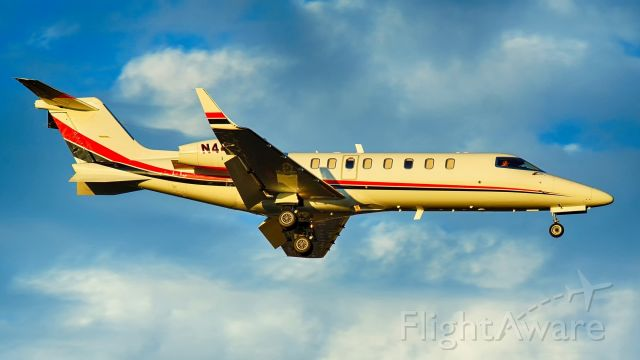Learjet 45 (N445SE) - 13R approach at sunset.