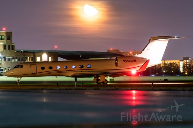 Gulfstream Aerospace Gulfstream V (N552MW) - G-V came in tonight. Unfortunately they parked it way over by Hangar 4 for whatever reason. Still managed this cool shot with the moon rising and Purdue's CRJ and G-IV.