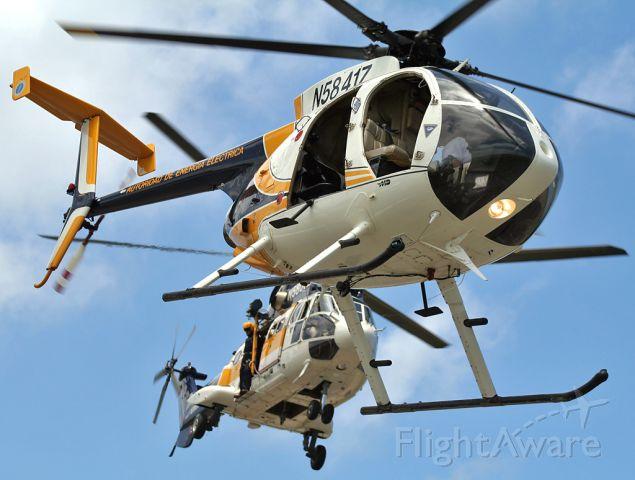 — — - Puerto Rico Electric Power Authority helicopters Super Puma AS332C (N5800Z) and MD530FF (N5841Z) taking off simultaneously
