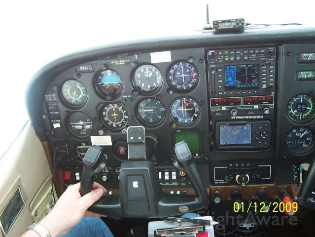 Cessna Skylane RG (N2AJ) - 11,000 feet over Tampa, FL after breaking out on top.
