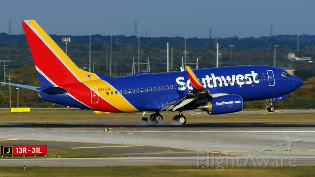 Boeing 737-700 (N7717D) - 13R arrival.