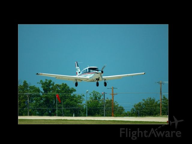 Piper PA-24 Comanche (N9XT) - Short final to Osage Beach, MO (K15) in 2007 for the Cherokee Fly In (OK, OK, its not a Cherokee, I know.....)