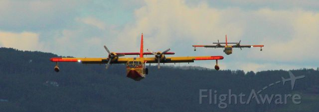 — — - CL-215's lined up on final to float pond to pickup water for forest fires close by.