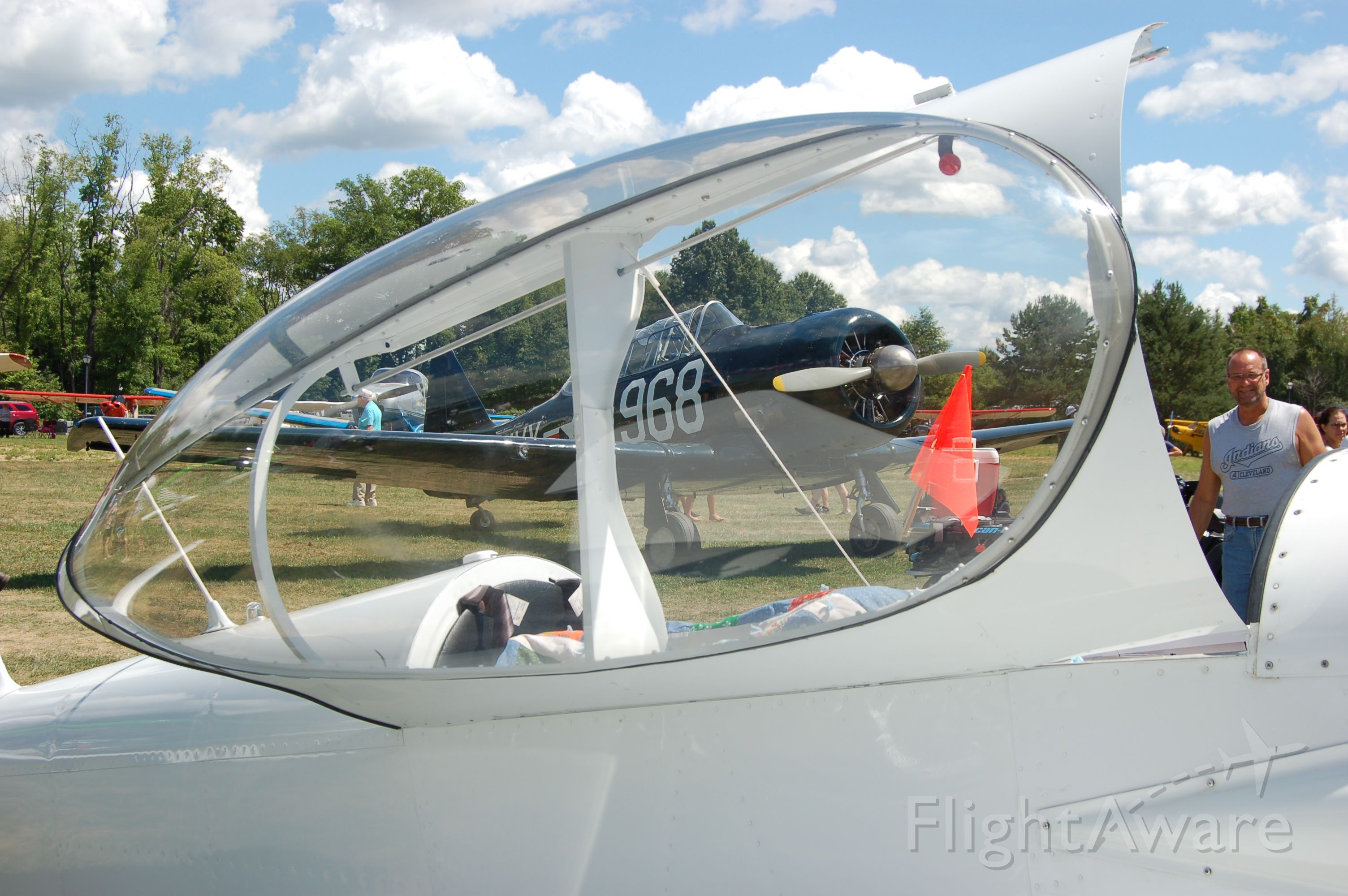 — — - Wings & Wheels 2016! Sloas Field. Cool shot of WWII vintage Navy SNJ (I think) through the canopy of a Homebuilt