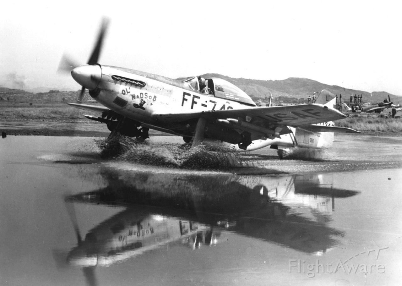 """North American P-51 Mustang — - My mom's boss in the 70's was Col. Robert P Pasqualicchio.  This was his plane and he had a picture of it hanging in his office. """"Ol' NaDSoB"""" was Napalm Droppin' Son of a B*tch!"""