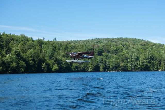 Cessna 206 Stationair (N7615N) - Helms Aero Service landing on Utowana Lake, NY