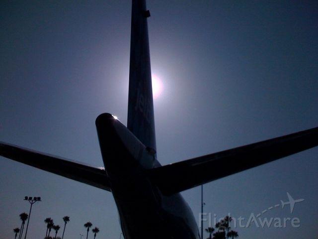 Embraer ERJ-190 (N247JB) - E190 tail, the sun casts a nice shadow on this bird. Courtesy of JetBlue Jae