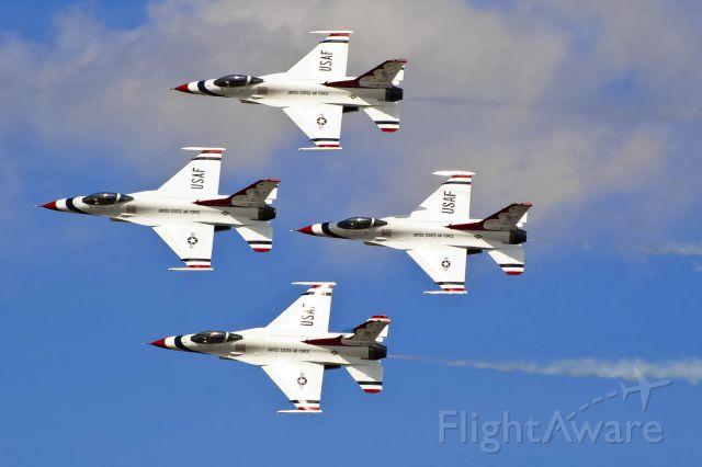 Lockheed F-16 Fighting Falcon — - The U.S. Thunderbirds do a diamond pass at Robins AFB.