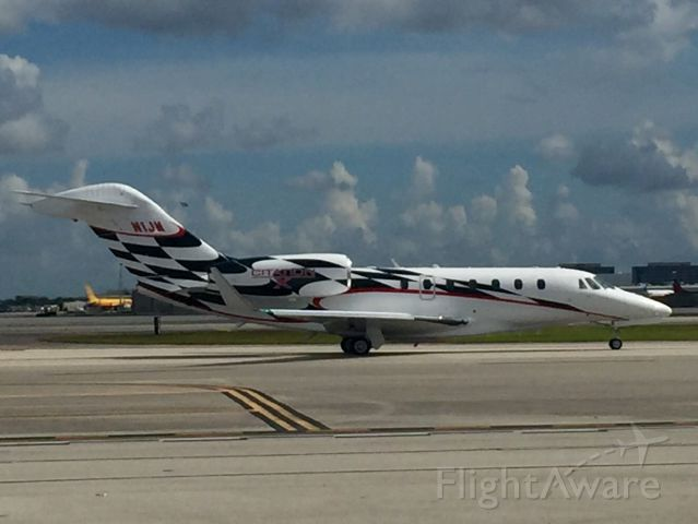 Cessna Citation X (N1JM) - This photo was taken on the flight line at Signature at Miami International while it was taxiing for takeoff.