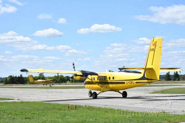 De Havilland Canada Twin Otter (C-FOPJ) - With her sister ship C-GOGC, getting ready for another rabies-vaccine drop around southwestern Ontario.