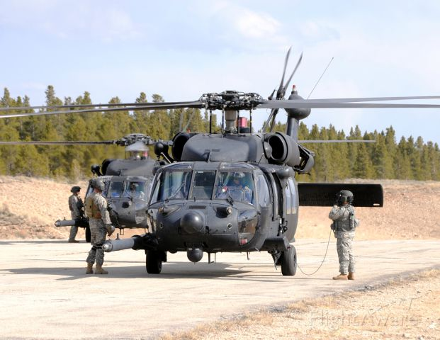 — — - Two MH-60s from the 160th Special Operations Aviation Regiment (SOAR) preparing for engine start-up.