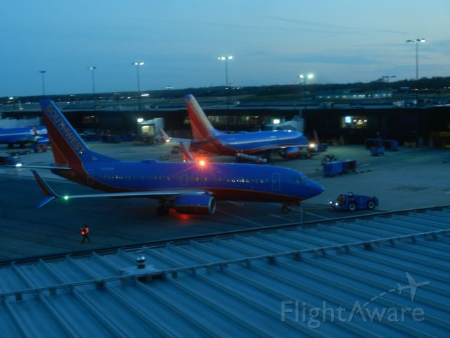 Boeing 737-700 (N256WN) - N256WN, A Boeing B737-7H4 Of Southwest Airlines, Is Pushed Back From The Gate On A Late Spring Evening, N256WN Was Built In 2006