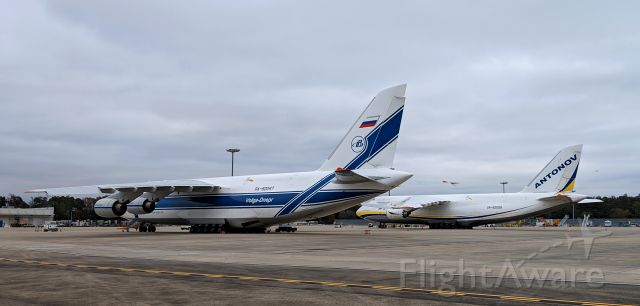 Antonov An-12 (RA-82047) - Two AN-124s resting overnight...which livery suits this plane best? UR-82009 and RA-82047
