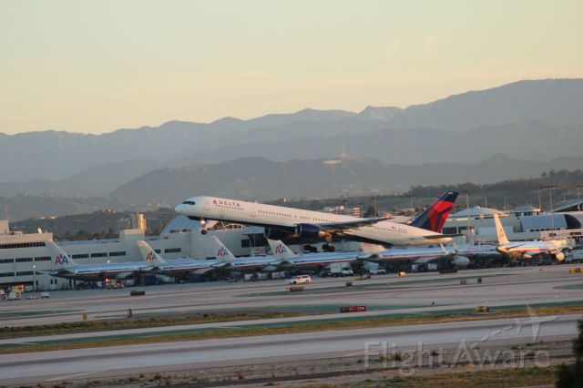 N589NW — - Delta Airlines 757 taking off from LAX on an early March morning as seen from overlook in El Segundo.  Canon EOS Rebel T3i, 75-300mm telephoto lens.