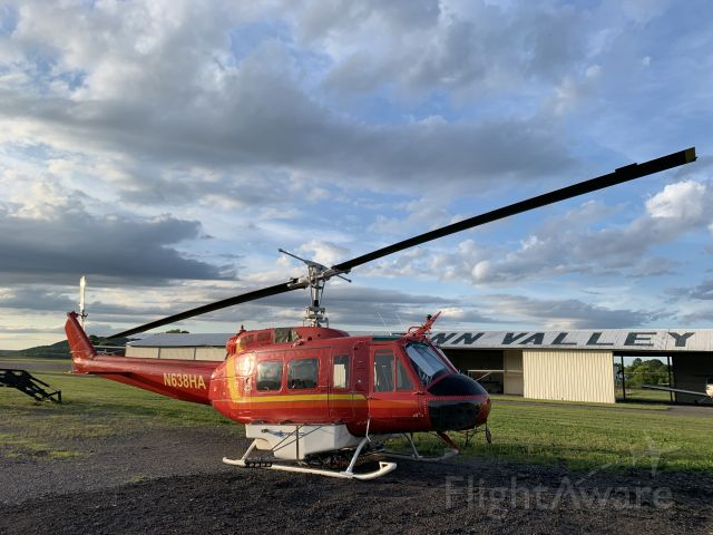 Bell UH-1V Iroquois (N638HA) - A helicopter casually sitting on a gravel pad overnight at Penn Valley.