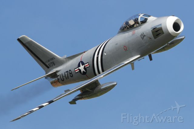 — — - A North American F-86 Sabre, performs a high speed flypast during the Duxford Spring Airshow 2013.