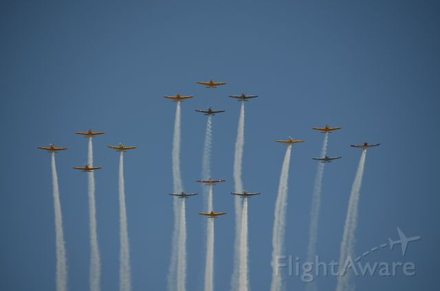 — — - EAA 2011 well flown formation of what I am pretty certain were T-34s.