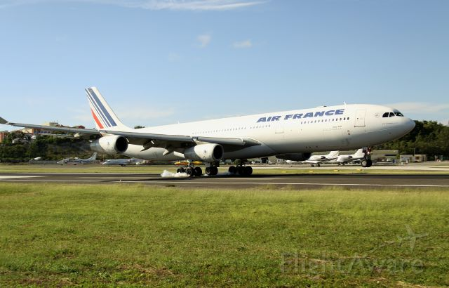 Airbus A340-300 (F-GLZS) - Air France F-GLZS touchcing down at TNCM
