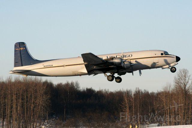 Douglas DC-6 (N400UA) - Rwy 32 departure, 02Mar09