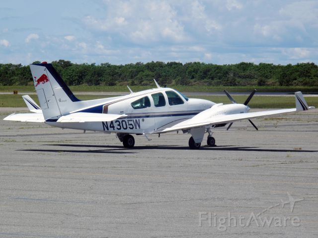 Beechcraft 55 Baron (N4305W) - Please take note of the winglets and the four bladed props.