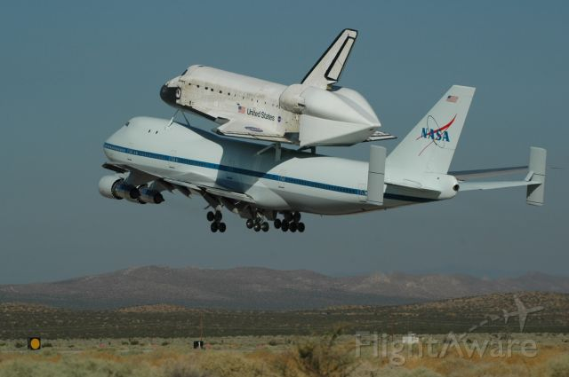 — — - Space Shuttle Discovery headed home from Edwards Air Force Base